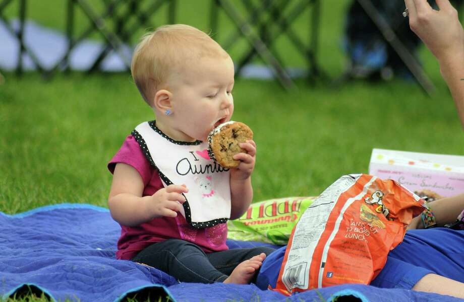 One year old Scarlett Sanislo, of The Woodlands, enjoys an ice cream during in the Concert in the Park at Northshore Park. The family friendly concerts are sponsored by The Woodlands Township.  Photo: David Hopper, For The Chronicle / freelance