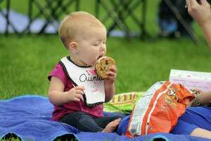 One year old Scarlett Sanislo, of The Woodlands, enjoys an ice cream during in the Concert in the Park at Northshore Park. The family friendly concerts are sponsored by The Woodlands Township. Photograph by David Hopper