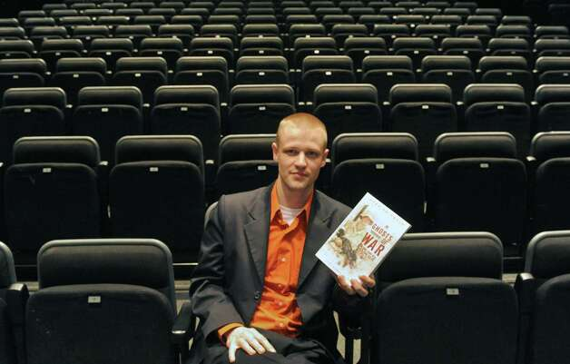 "Ryan Smithson a local Iraq veteran who wrote the book ""Ghosts of War"" is having his story translated to a play on the stage of Proctor's in March Thursday Feb. 26, 2015 in Schenectady, N.Y. (Michael P. Farrell/Times Union) Photo: Michael P. Farrell / 00030764A"