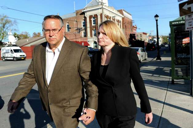 An FBI investigation of former Halfmoon Supervisor Melinda A. Wormuth was triggered by a $50,000 payment that Halfmoon builder Bruce Tanski gave to the business of Wormuth's husband, Larry, left. The couple is pictured here leaving her arraignment on felony charges in Waterford Town Court in October 2013. (Cindy Schultz / Times Union) Photo: Cindy Schultz