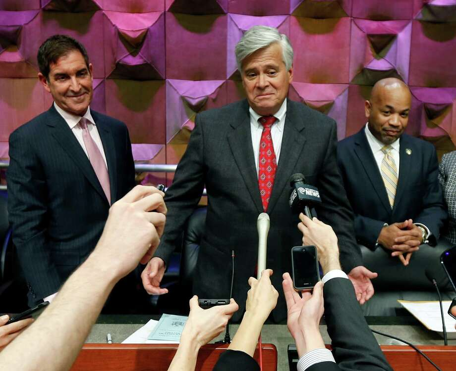 Independent Democratic Conference Leader Sen. Jeff Klein, D-Bronx, left, Senate Republican leader Dean Skelos, R-Rockville Centre, center, and Assembly Speaker Carl Heastie, D-Bronx, talk to reporters after a budget meeting on Thursday, March 19, 2015, in Albany, N.Y. (AP Photo/Mike Groll)  ORG XMIT: NYMG105 Photo: Mike Groll / AP