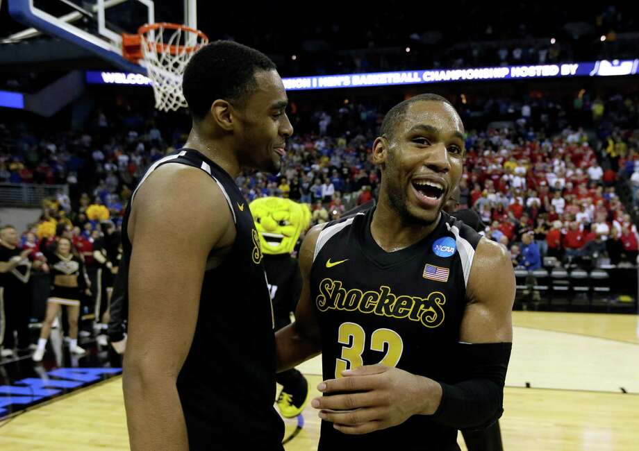Wichita State guard Tekele Cotton, right, celebrates with teammate Darius Carter after an NCAA college basketball tournament Round of 32 game against Kansas, Sunday, March 22, 2015, in Omaha, Neb. Wichita State won 78-65. (AP Photo/Charlie Neibergall) ORG XMIT: NECN120 Photo: Charlie Neibergall / AP