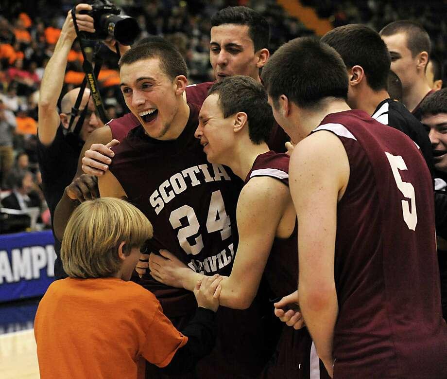 Scotia's Joe Cremo, #24, celebrates with his team after defeating Greece Athena Class A boys' basketball state final on Sunday, March 22, 2015 in Glens Falls, N.Y. (Lori Van Buren / Times Union) Photo: Lori Van Buren / 10031112A
