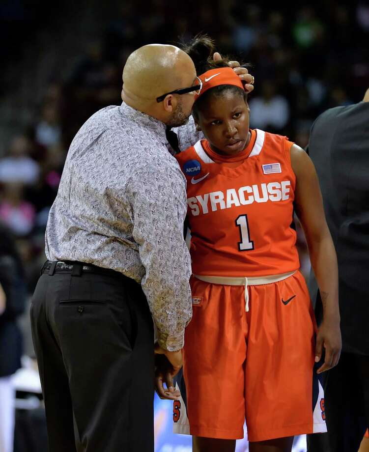 Syracuse coach Quentin Hillsman consoles Alexis Peterson during the first half of a college basketball game against South Carolina in the second round of the NCAA tournament Sunday, March 22, 2015, in Columbia, S.C. South Carolina won 97-68. (AP Photo/Richard Shiro) ORG XMIT: SCRS115 Photo: Richard Shiro / FR159523 AP