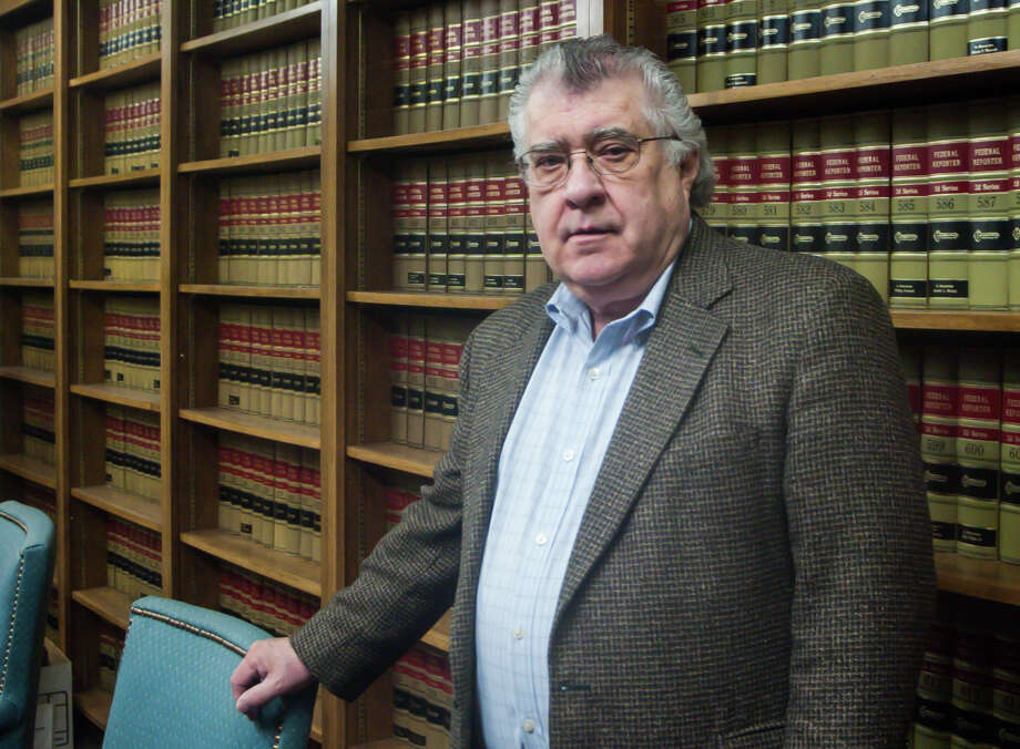 Attorney Philip Russ, in the library of his office on March 6, 2015, in Amarillo, TX.  Russ is the defense attorney who is claiming that the lawsuit against his client should be considered a medical malpractice case since the farmer is a retired doctor and was responsible for the care of the cattle. Photo: Michael Norris, Chronicle / {copyright}2015 Houston Chronicle2015 Houston Chronicle2015 Houston Chronicle2015 Houston Chronicle