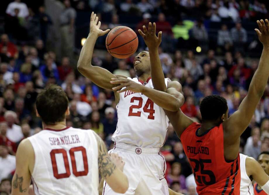 Oklahoma's Buddy Hield (24) battles Dayton's Kendall Pollard (25) for ball in the second half of an NCAA tournament college basketball game in the Round of 32 in Columbus, Ohio, Sunday, March 22, 2015. (AP Photo/Tony Dejak) ORG XMIT: OHMD124 Photo: Tony Dejak / AP