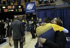 Sheila Haney hugs her daughter Brittany Shine of the Cal womens team after a basketball game between California and Texas in the second round of the NCAA Tournament in Berkeley, Calif, on Sunday, March 22, 2015. The Texas Longhorns defeated the California Bears to advance to the third round of the tournament.