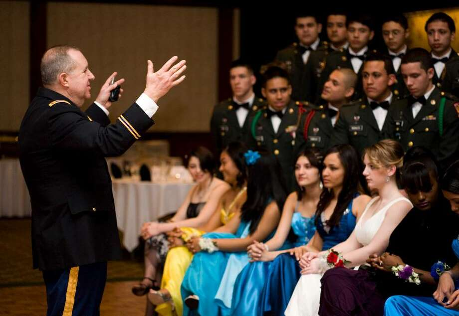 Major William Weber, left, organizes members of the JROTC program at Westhill High School for a group photograph during the JROTC Military Ball at the Italian Center on March 5, 2010. Photo: Kerry Sherck / Stamford Advocate Freelance
