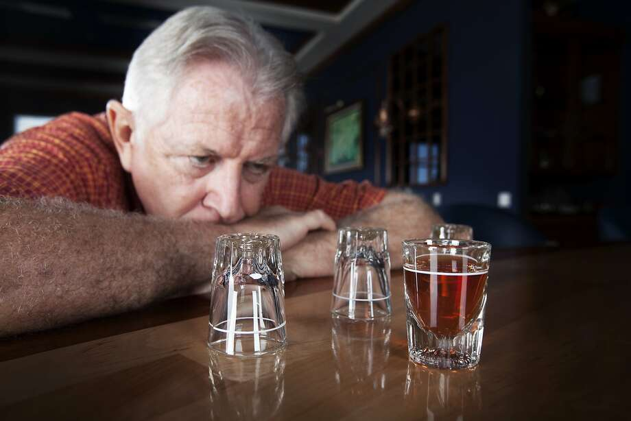 A twin doesn't know how to help his alcoholic brother get help for his addiction. Photo: Terry J Alcorn, Getty Images