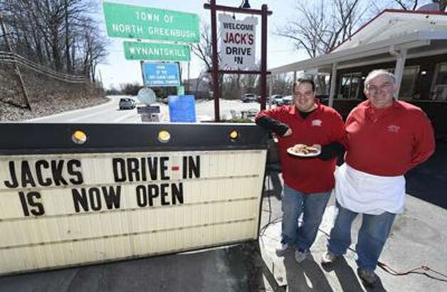 Al and Joe Deeb open the doors on Jack's Drive in in Wynantskill Monday. Despite cold temperatures, business was brisk. (Skip Dickstein / Times Union)