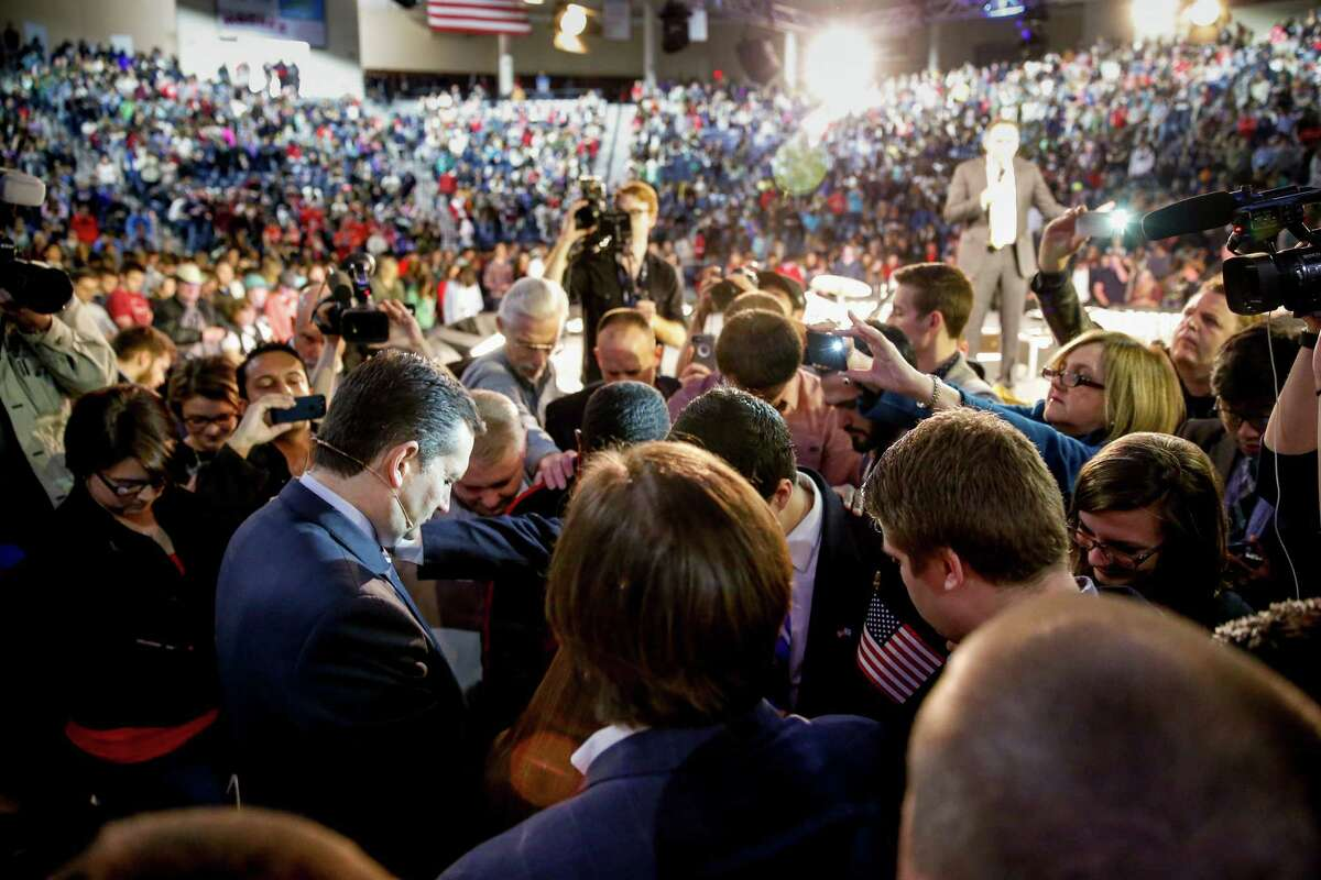 Sen. Ted Cruz, R-Texas prays with members of the audience after announcing his campaign for president, Monday, March 23, 2015, at Liberty University, founded by the late Rev. Jerry Falwell, in Lynchburg, Va. Cruz, who announced his candidacy on twitter in the early morning hours, is the first major candidate in the 2016 race for president. (AP Photo/Andrew Harnik)