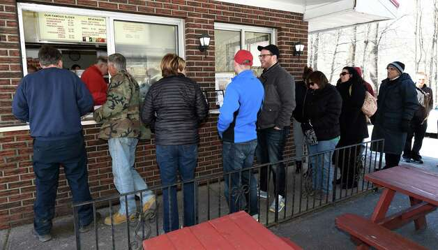 Customers brave the cold and queue up for a  border or hotdog on the 77th opening day at Jack?s Drive In Monday morning, March 23, 2015, in Troy, N.Y. (Skip Dickstein/Times Union) Photo: SKIP DICKSTEIN / 00031141A