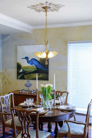 The Millers' dining room includes this potrait of the blue heron which comes to visit in the warm weather. Photo: Vincent Giordano/518Life / 2014