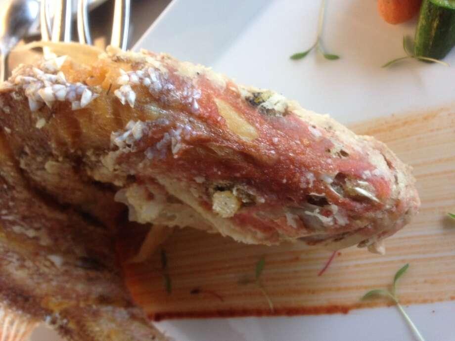 Whole fried fish at Peska Seafood Culture. (Photo: Greg Morago)