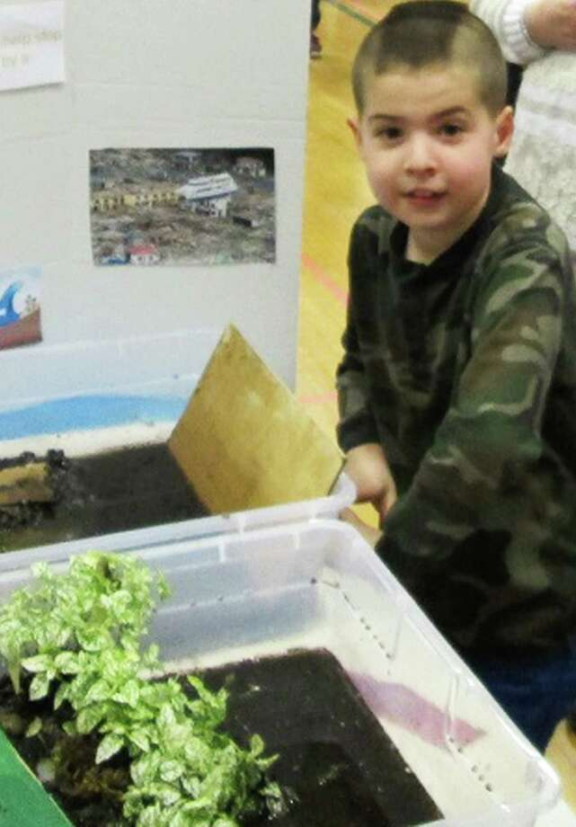 Liam MacKessy, a third grader at John Pettibone School n New Milford, poses proudly with his project during the science fair. March 2015  Courtesy of Pettibone School Photo: Contributed Photo / The News-Times Contributed