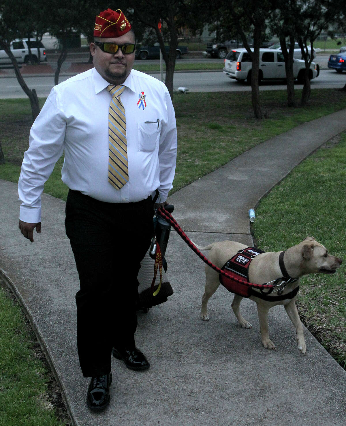 Juan Alonzo Miranda walks with his service dog, Goldie, to the courthouse March 16 for the first day of the trial.