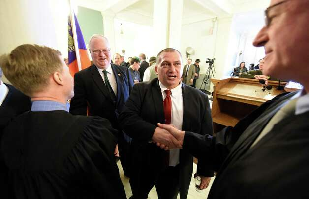 Mark Caruso, center, is congratulated by other judges after being sworn in as the new City Court Judge Monday morning March 23, 2015 in Schenectady, N.Y.  (Skip Dickstein/Times Union) Photo: SKIP DICKSTEIN / 00031139A