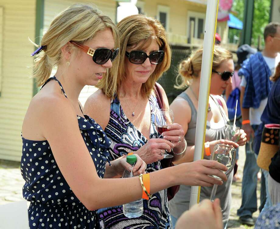 Bailey Allen, left, and Sue Pokorny ask for another sample of wine during last year's Springfest in Old Town Spring. The wine exhibition and tasting events will be held March 28-29 in Old Town Spring. Photo: David Hopper, Freelance / freelance