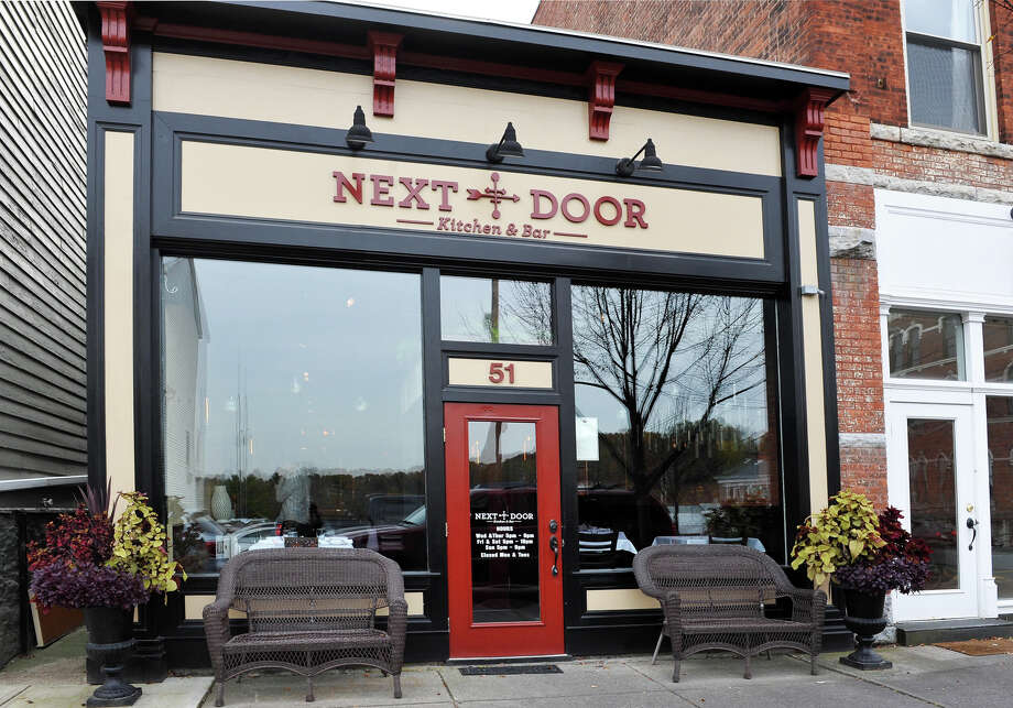 Entrance to the Next Door Kitchen & Bar on Front Street Tuesday Oct. 28, 2014,in Ballston Spa, NY. Photo: John Carl D'Annibale/518Life / 518Life Magazine