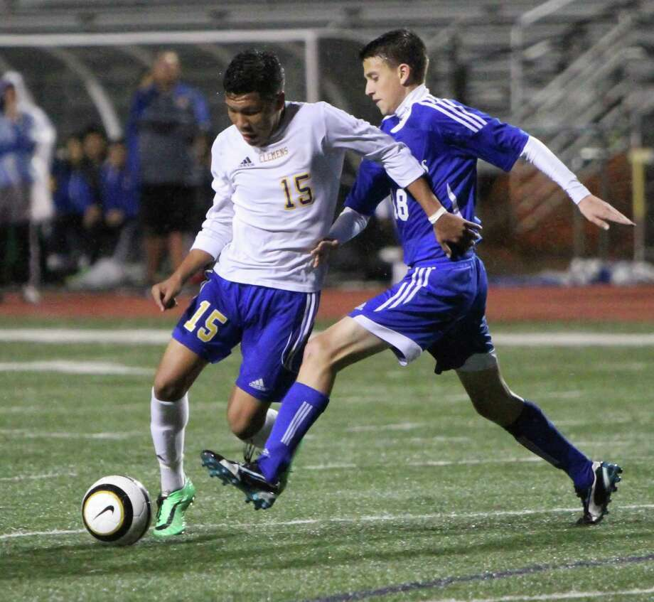 Clemens's Mike Maldonado moves past New Braunfels' Colton Herrera during Clemens' 1-0 victory Friday, March 20. The win kept Clemens undefeated, at 18-0-1 on the year. Photo: Greg Bell / For The NE Herald