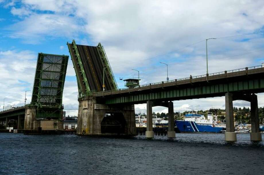 The Ballard Bridge is stuck in the open position Thursday afternoon,  prompting transportation agencies to advise drivers to find different  routes. Photo: Jordan Stead, Seattlepi.com
