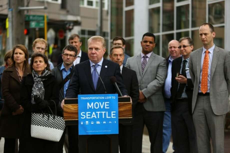 "Mayor Ed Murray demands much from his city's voters.  Here, he announces the $930 ""Move Seattle"" transportation levy, nearly triple the previous $365 ""Bridging the Gap.""  Street repairs promised in the 2006 levy hadn't been made then, still haven't been made.  But generous Seattle voters passed the levy.  Photo: Joshua Trujillo, Seattlepi.com"