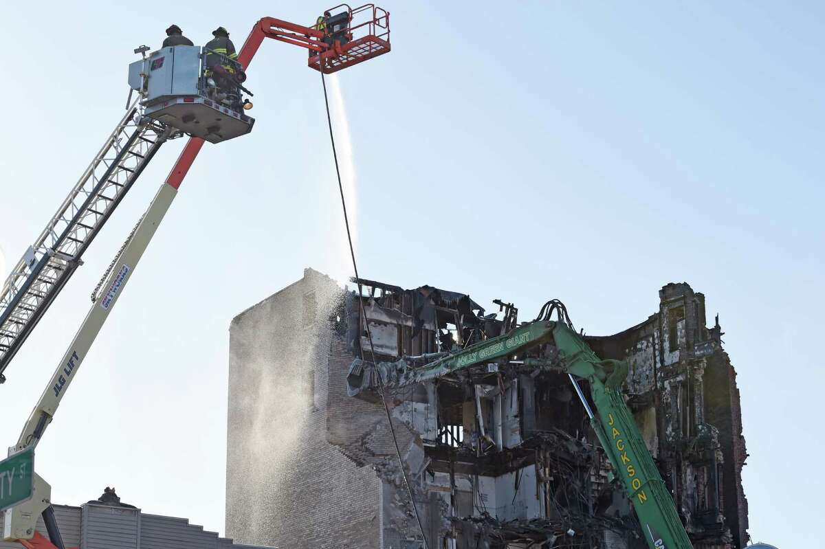 Demolition continues at the fire scene on Jay Street Monday morning March 23, 2015 in Schenectady, N.Y. (Skip Dickstein/Times Union)
