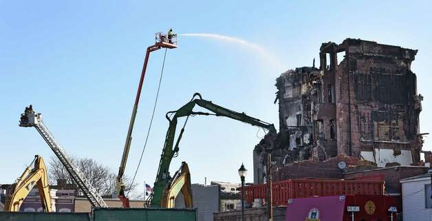 Demolition continues at the fire scene on Jay Street Monday morning March 23, 2015 in Schenectady, N.Y.         (Skip Dickstein/Times Union) Photo: SKIP DICKSTEIN
