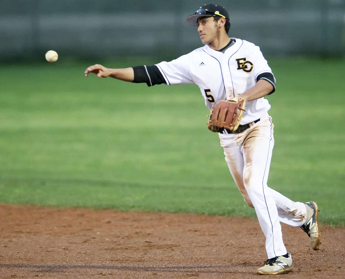 East Central's Joseph Gutierrez throws to first during the sixth inning of their game with Roosevelt at East Central on March 20. East Central beat Roosevelt 10-3.