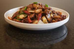Cumin beef, a speciality dish at Mala Sichuan Bistro, is displayed, Monday, December 19, 2011, in Houston, Texas. (TODD SPOTH FOR THE CHRONICLE)