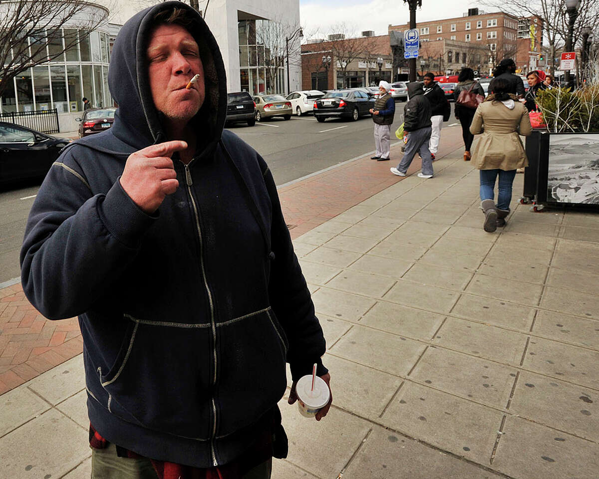 People outside the McDonalds, where a man was stabbed last week, in downtown Stamford, Conn., on Wednesday, March 18, 2015.