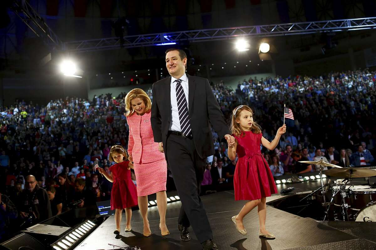"""Sen. Ted Cruz (R-Texas) with his wife, Heidi Nelson Cruz, and daughters, Caroline and Catherine, at Liberty University in Lynchburg, Va., March 23, 2015. Cruz on Monday formally announced his candidacy for the 2016 Republican presidential nomination, promising a campaign that would be about �""""re-igniting the promise of America."""" (Travis Dove/The New York Times)"""