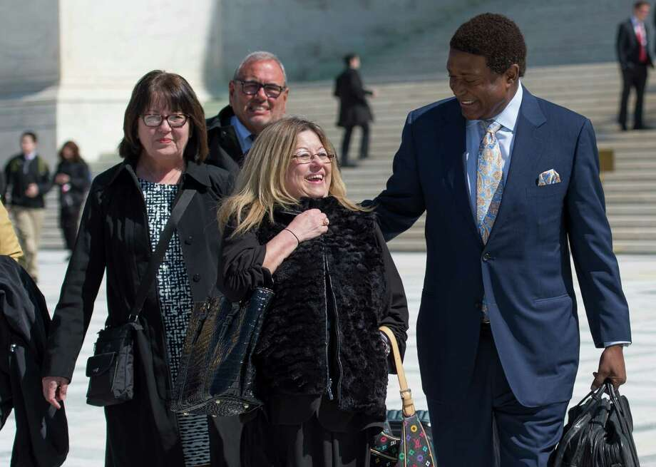 Frances Sheehan (left) and Joanne Sheehan leave the Supreme Court building with lawyer John Burris, who is representing their sister Teresa. Photo: Molly Riley / Associated Press / FR170882 AP
