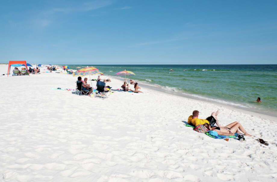 Besides crowds of beach-goers, warm Gulf of Mexico waters have naturally occurring bacteria that can cause infection of minor cuts, although incidents are relatively rare, especially among people who are otherwise healthy.  Photo: Stephen Saks, Getty Images/Lonely Planet Images / Lonely Planet Images