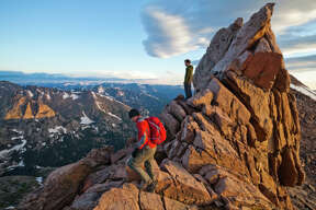 Hikers stand in the Keyhole on Longs Peak, Rocky Mountain National Park, Colorado.