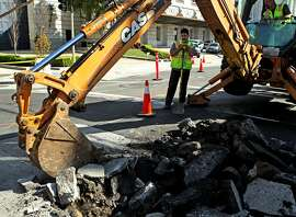 Construction on Franklin and Grove streets close down a block and clogs traffic, Wednesday, March 18, 2015, in San Francisco, Calif. Many construction sites can be seen along Franklin and Gough streets.