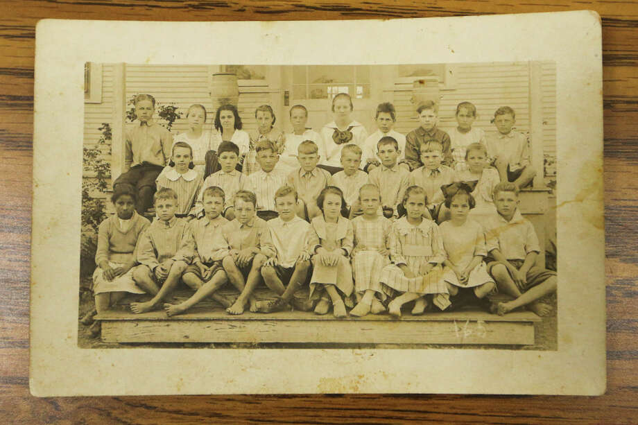 A Converse School photograph from the mid-1910's on display during the Bexar County Rural Schools annual reunion at the Knights of Columbus Council 4315 building, 5721 Rigsby, on Sunday, March 8, 2015.  MARVIN PFEIFFER/ mpfeiffer@express-news.net Photo: Marvin Pfeiffer, Staff / San Antonio Express-News / Express-News 2015