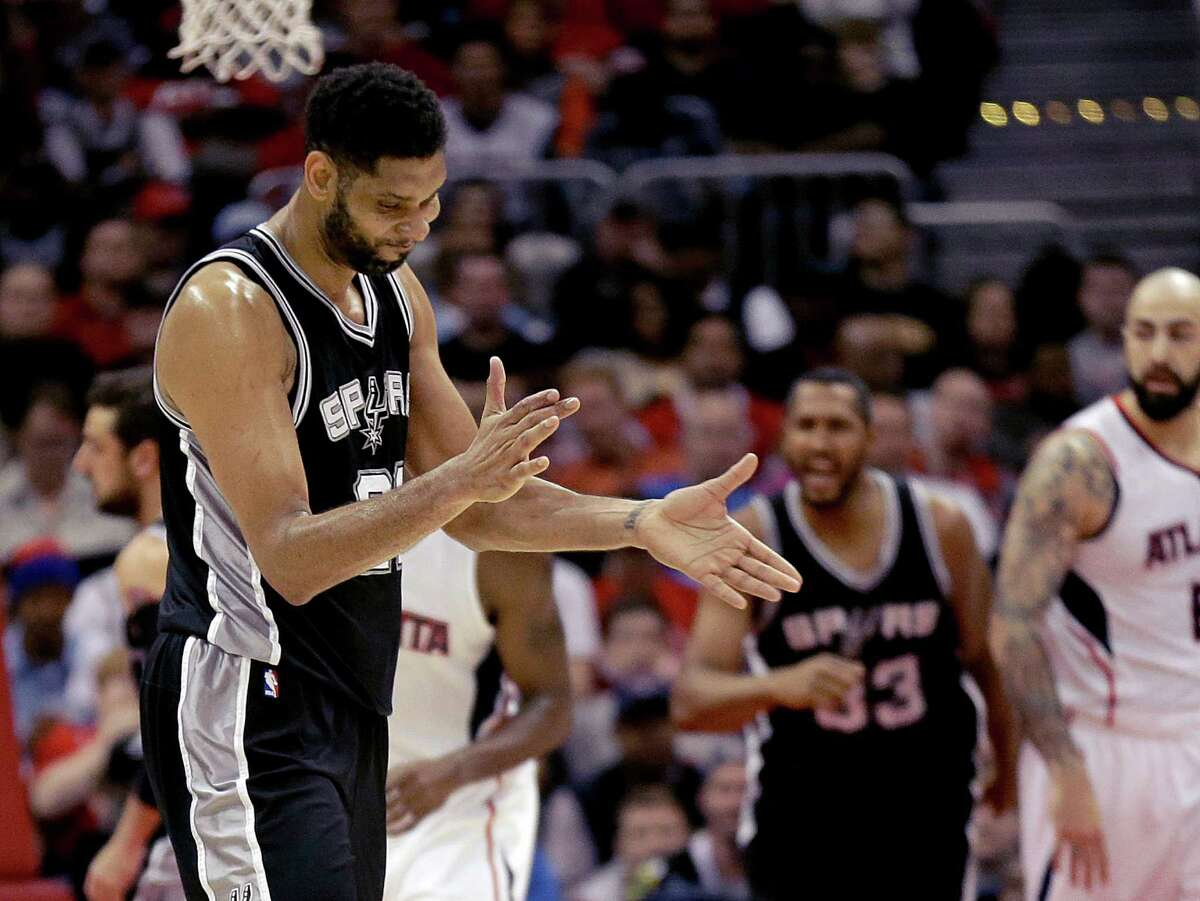 Spurs captain Tim Duncan applauds after hitting a two-point basket during the third quarter against the Atlanta Hawks. The Spurs won 114-95.