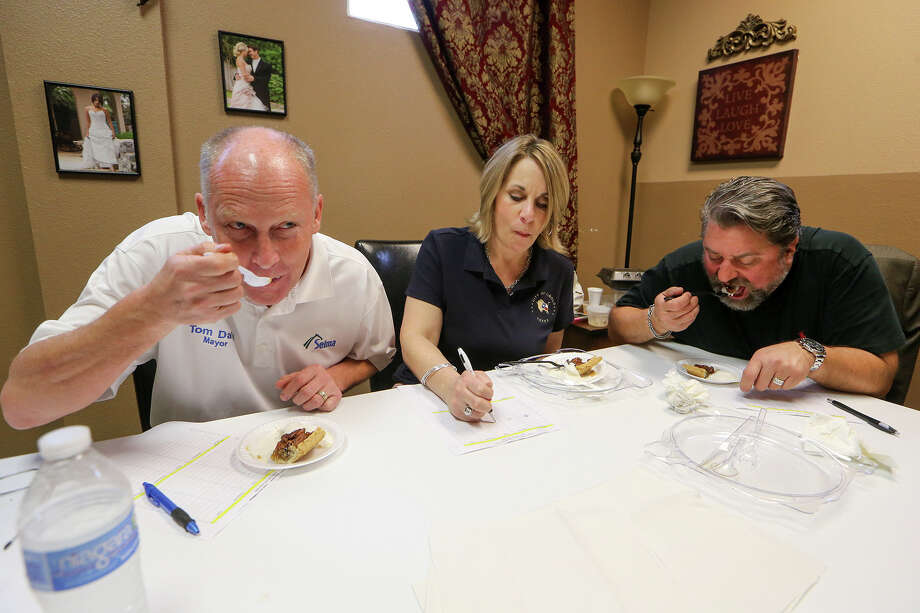 "Selma Mayor Tom Daly, Cibolo Mayor Lisa Jackson and Schertz Mayor Michael Carpenter serve as judges during ""The Taste: All American"" at the Schertz Civic Center, 1400 Schertz Parkway, on Thursday, March 19, 2015.  More than two dozen local restaurants, caterers and businesses were on hand with samples of their best menu items.  MARVIN PFEIFFER/ mpfeiffer@express-news.net Photo: Marvin Pfeiffer, Staff / San Antonio Express-News / Express-News 2015"