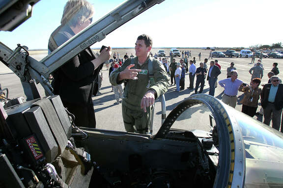 Lt. Col. Robert Lee, director of operations for the 560th Flying Training Squadron, answers questions about the T38 aircraft he just landed during a ceremony to open airfield operations at the Joint Base San Antonio-Randolph Seguin Auxiliary Airfield on Jan. 20.