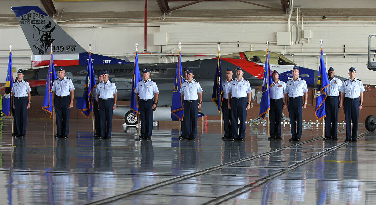 Air Force personnel from the various training wings under the 19th Air Force stand at attention near an F-16 aircraft during the 19th Air Force Inactivation Ceremony at Randolph Air Force Base on July 12, 2012. The 19th Air Force was responsible for training personnel to fly a variety of aircraft. The 19th was established in 1955 at Foster Air Force Base before it was assigned to Air Education and Training Command at Randolph Air Force Base in 1993.