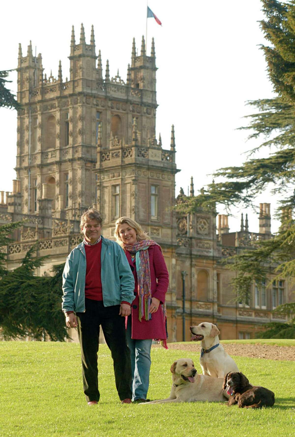The current Earl and Countess of Carnarvon pose in front of the family home, Highclere Castle, in a portrait reminiscent of the Downton Abbey cast photo. (File photo.)
