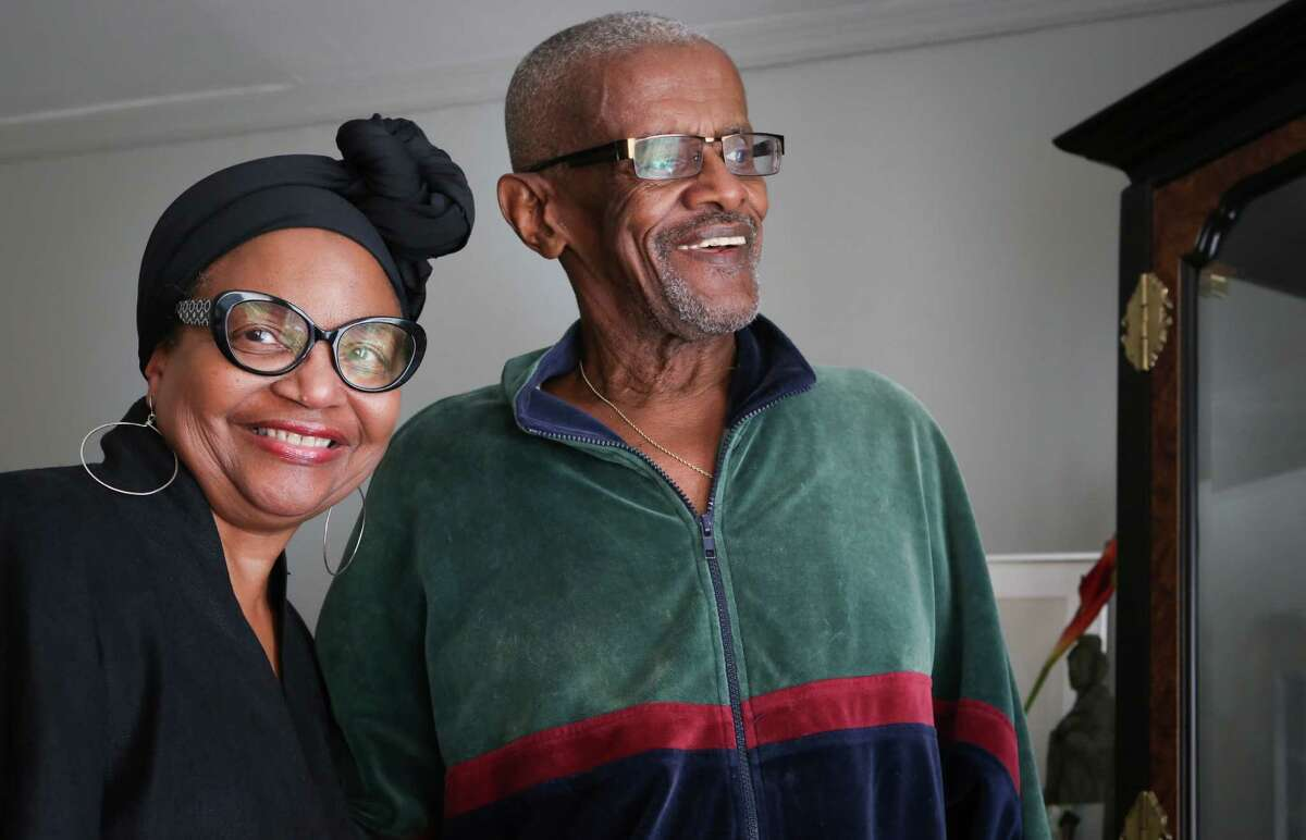 Chris Mason and her husband, Nathaniel, stand in their home of more than 20 years in Oakland.