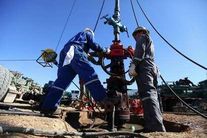 Crude's fall hits hard in Texas, harder elsewhere - HoustonChronicle com