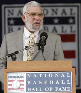 Nick Peters speaks after being presented with the J.G. Taylor Spink sportswriter award at the Baseball Hall of Fame in Cooperstown, N.Y., Sunday, July 26, 2009. (AP Photo/Mike Groll)
