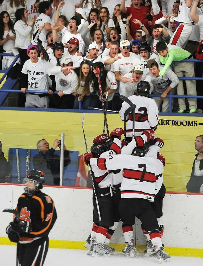 New Canaan's Tim Robustelli jumps up to the fans as he scores in the second period against Ridgefield in the FCIAC boys hockey championship game at Terry Conners Rink in Stamford, Conn. on Saturday, March 6, 2010. Photo: Kathleen O'Rourke / Stamford Advocate