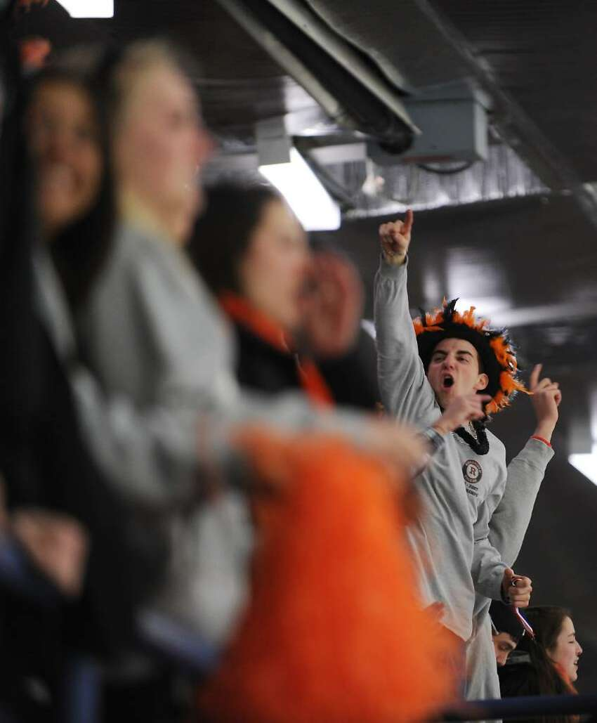Ridgefield fans cheer on their team in the FCIAC boys hockey championship game at Terry Conners Rink in Stamford, Conn. on Saturday, March 6, 2010.