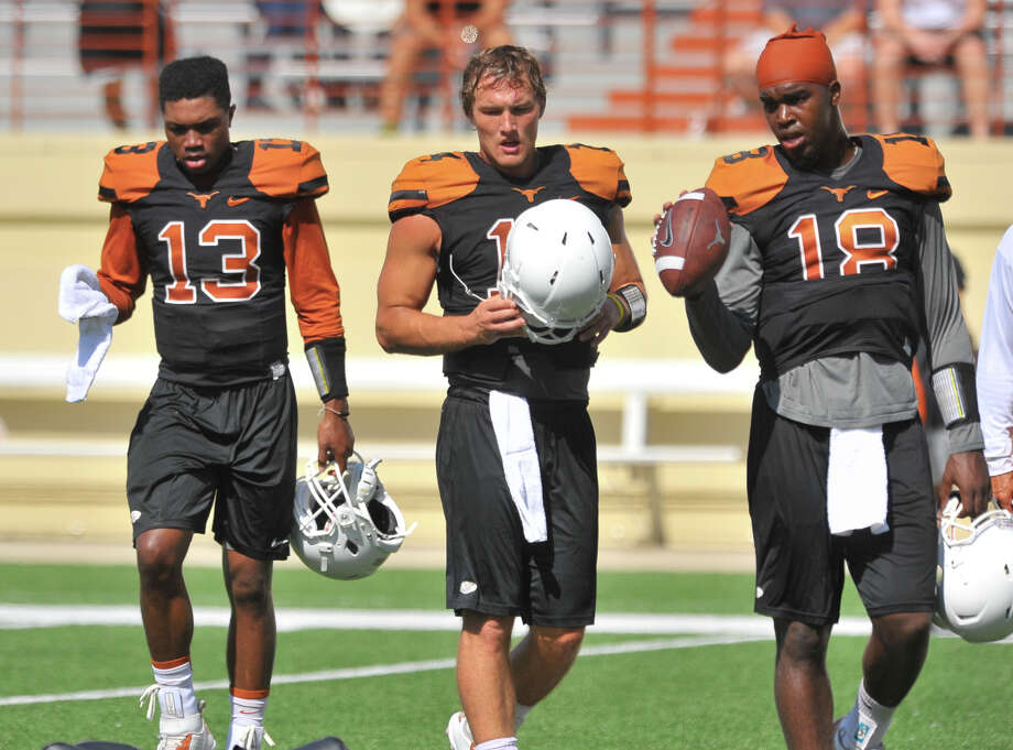Texas is hoping that either Jerrod Heard (left) or Tyrone Swoopes (right) can emerge as the clear-cut starter at quarterback in 2015, just as David Ash (center) did before a concussion in last year's opener forced him to end his playing career. Photo: Robin Jerstad /For The Express-News / San Antonio Express-News