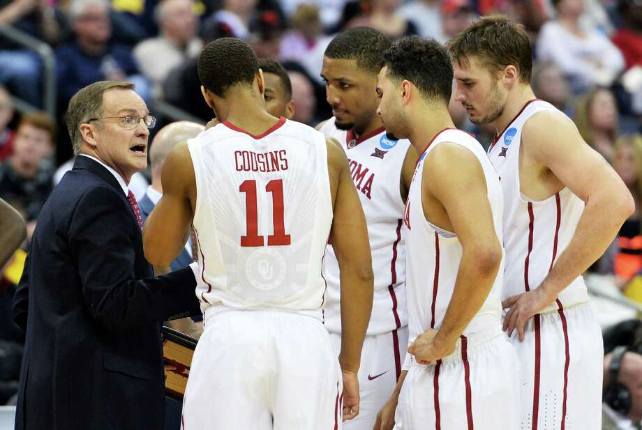 Head coach Lon Kruger of the Oklahoma Sooners talks to his team in the second half against the Dayton Flyers during the third round of the 2015 NCAA men's tournament at Nationwide Arena on March 22, 2015 in Columbus, Ohio. Photo: Jamie Sabau /Getty Images / 2015 Getty Images