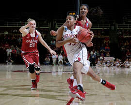 Stanford's Amber Orrange zips past Oklahoma's Kaylon Williams (right) and Gabbi Ortiz on her way to a 24-point performance in her final game at Maples Pavilion.